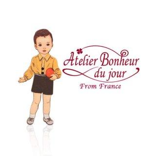 フランス輸入ボタン アトリエ・ボヌール・ドゥ・ジュール【黄色い服の男の子】