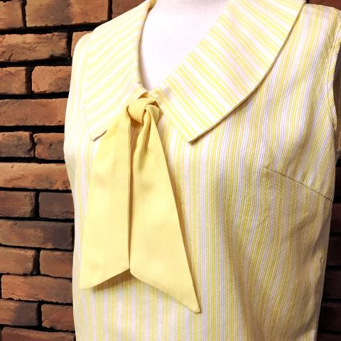 <img class='new_mark_img1' src='//img.shop-pro.jp/img/new/icons13.gif' style='border:none;display:inline;margin:0px;padding:0px;width:auto;' />Yellow Striped Top w/Bow Tie