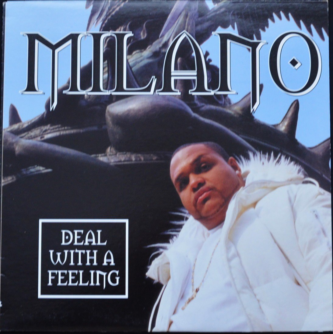 MILANO / DEAL WITH A FEELING (PROD BY SHOW) / REP FOR THE SLUMS (PROD BY AHMED) (12