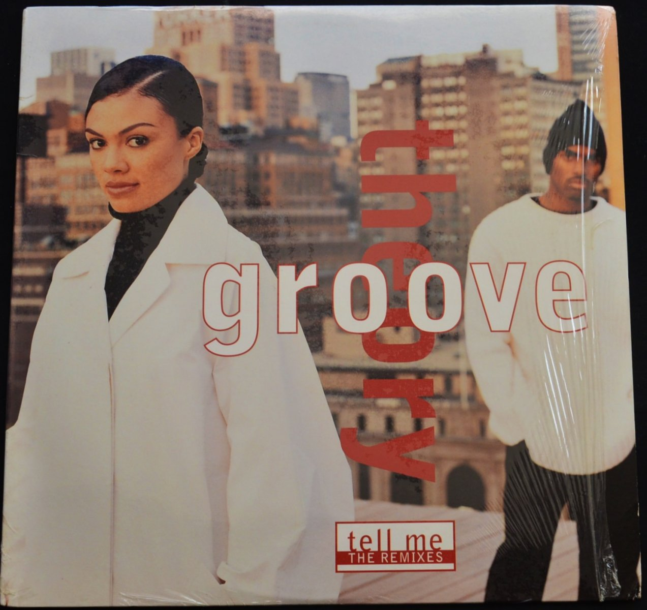 GROOVE THEORY / TELL ME (THE REMIXES) (12