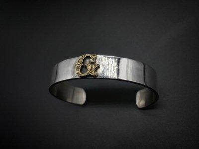 the united jewelry/emblem bangle/silver/brass