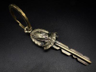 silly essence/praying hands custom key/brass